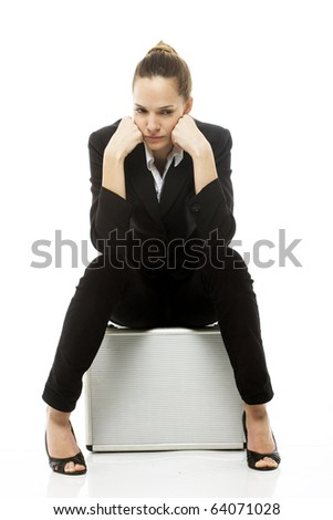 Young businesswoman sitting on a briefcase on white background studio