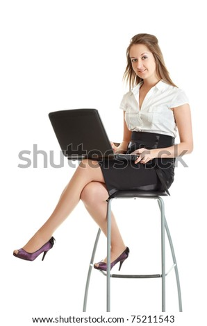 young businesswoman sitting on chair with laptop, isolated on white