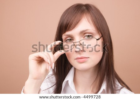 Young businesswoman smiling isolated on beige background