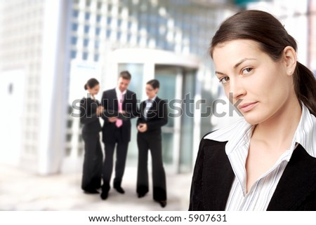 Young businesswoman standing in front of an office building.
