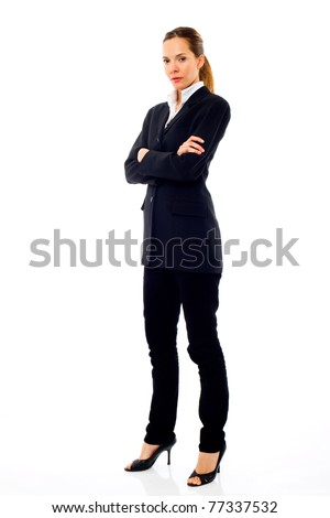 Young businesswoman standing with arms crossed on white background studio