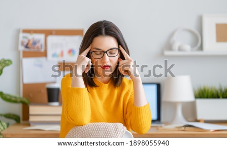 Young businesswoman studying online, watching webinar, podcast on laptop and having a head ache. E-learning concept. Foto stock ©