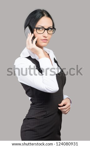 Young businesswoman talking by phone