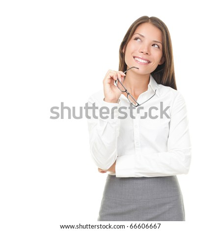 Young businesswoman thinking smiling looking up holding glasses. Isolated on white background. Young Asian / Caucasian female model.