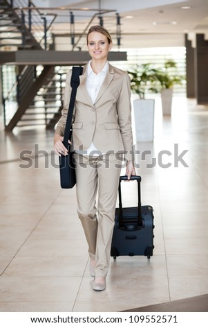 young businesswoman traveller walking at airport