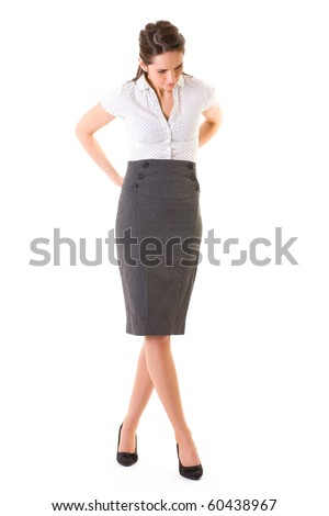 young businesswoman trying to fix her skirt, full body shoot, studio shoot isolated on white