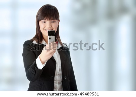 Young businesswoman using cell phone
