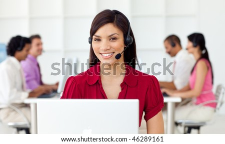 Young Businesswoman using headset in a call center