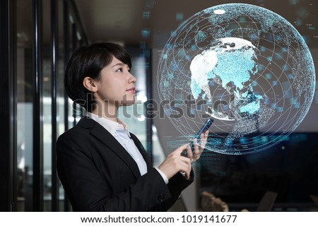 Young businesswoman watching GUI of world map. GLobal business concept.