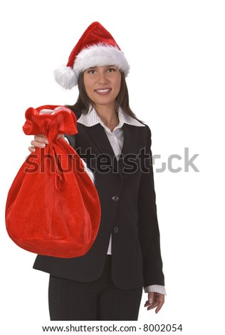 Young businesswoman wearing a Santa's hat and offering a red sack full of gifts.