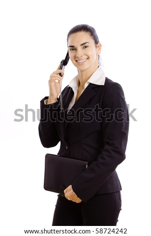 Young businesswoman wearing black suit,  holding personal organizer, talking on mobile phone. Isolated on white background.