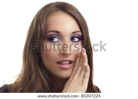 Young businesswoman whispering something to someone - stock photo