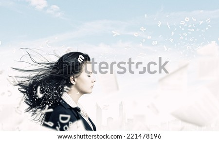 Young businesswoman with closed eyes and wind blowing in her face #221478196