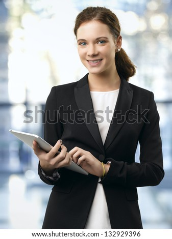Young Businesswoman with Digital Tablet in Office
