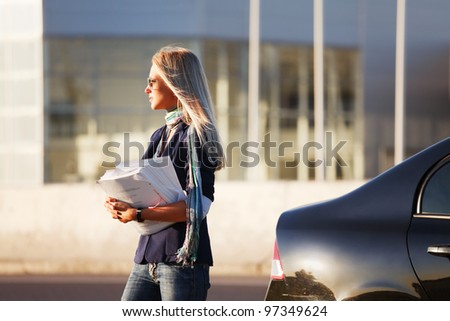 Young businesswoman with financial reports