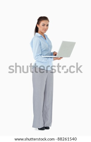 Young businesswoman with her laptop against a white background