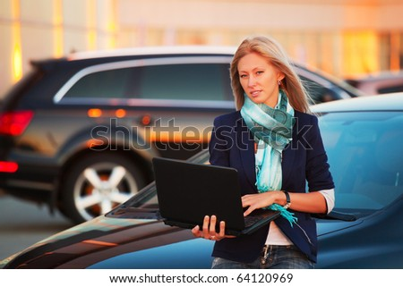 Young businesswoman with laptop.
