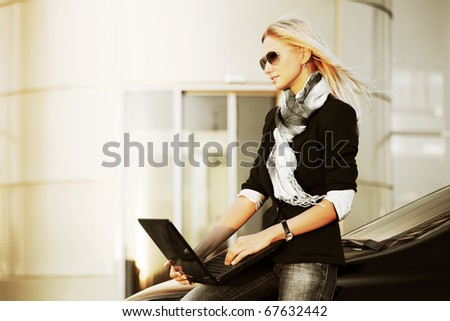 Young businesswoman with laptop. - stock photo