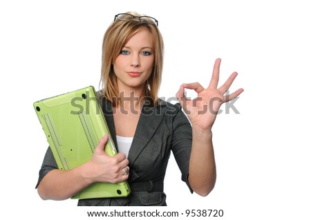 Young businesswoman with laptop giving the OK sign