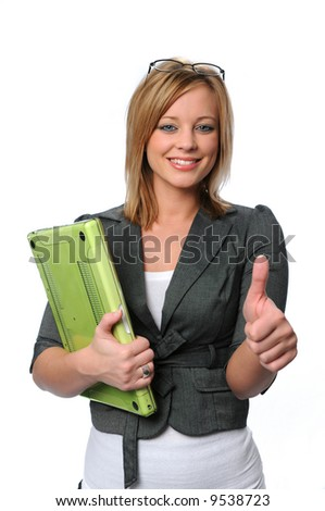 Young businesswoman with laptop giving the thumbs up sign