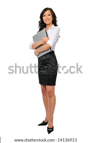 Young businesswoman with laptop isolated on white and standing