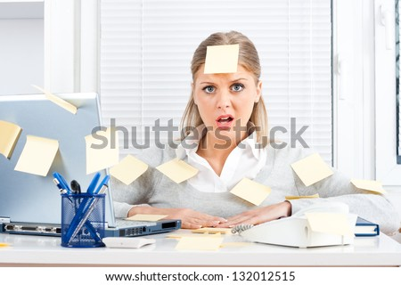 Young businesswoman with too much work to do,Overworked