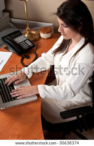 Young businesswoman working in the office in her computer.