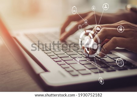 Young businesswoman working on his laptop in the office, select the icon cloud on the virtual display.Concept digital technology and cloud technolog