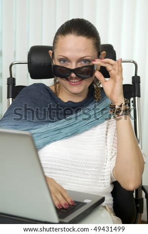 Young businesswoman, working with laptop in office