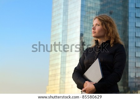 Young businesswomen holding laptop. It's her internet business, and she is successful businesswomen