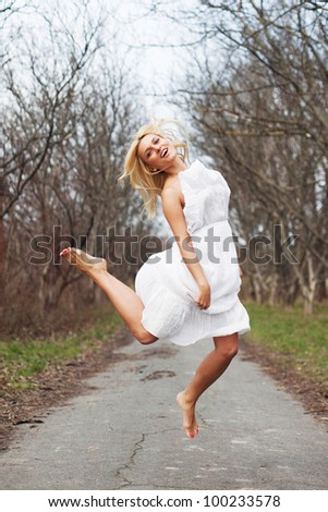 young carefree woman jumping