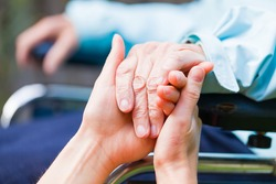Young carer giving helping hands for the elderly woman