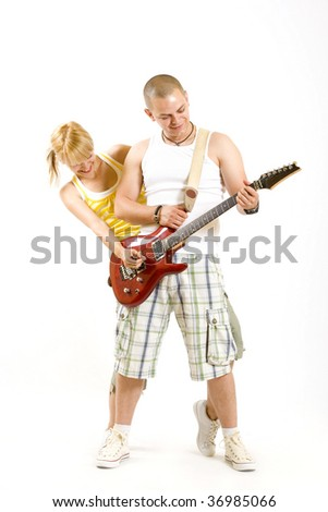young casual couple playing an electric guitar - stock photo