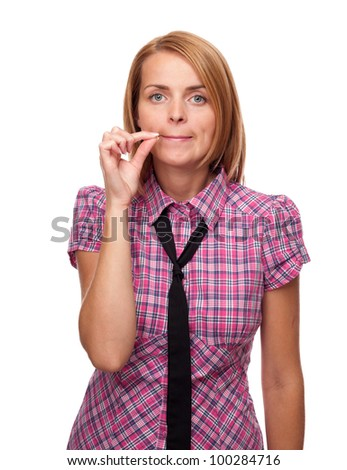 Young casual girl shows silence or secret gesture isolated on white background