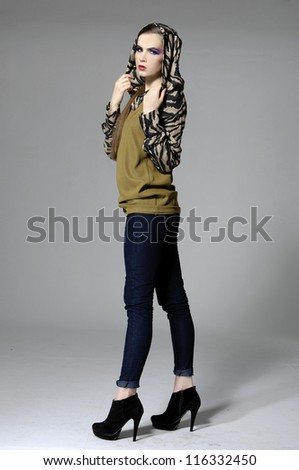 young casual man full body fashion woman posing on gray background