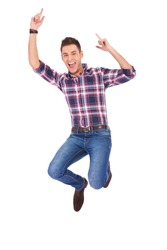 young casual man jumping for joy on white background