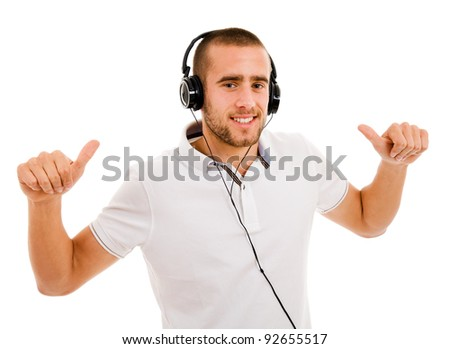 young casual man listening to music. Isolated on white background.