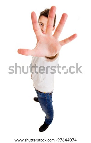 young casual man showing stop gesture with his hand, isolated on white