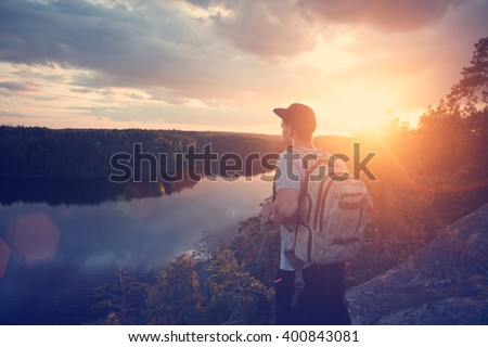 young casual man with backpack...