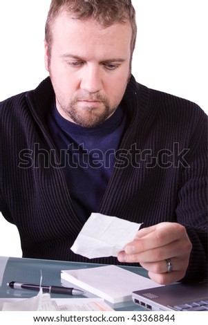 Young  Casual Professional Reviewing Receipts at Work - Isolated Background