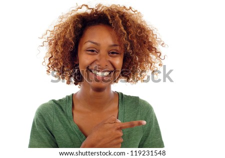 Young casual smiling black woman pointing sideways isolated over white
