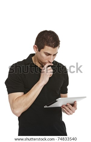 Young casual student working on a digital tablet. Isolated on a white background - stock photo