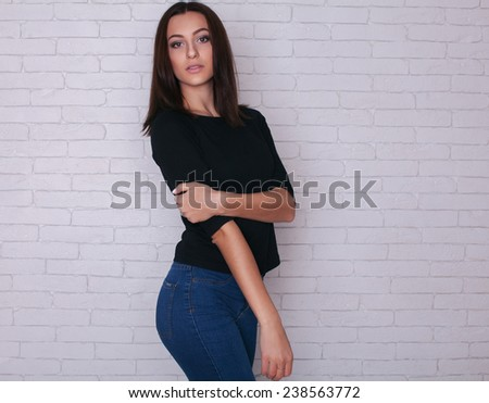Young casual style woman portrait over white background. #238563772