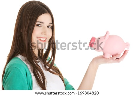 Young casual woman holding piggy-bank. Isolated on white.