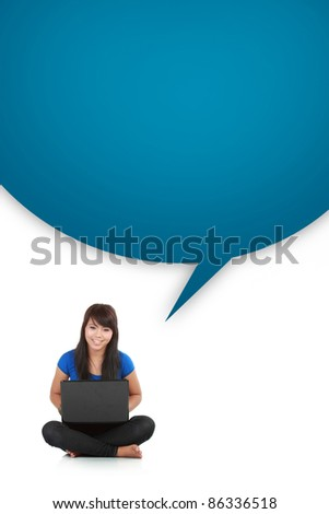young casual woman sitting down smiling holding laptop with box word isolated background
