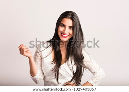 Young casual woman style isolated over white background. studio portrait female model. Beautiful smiling happy girl. #1029403057