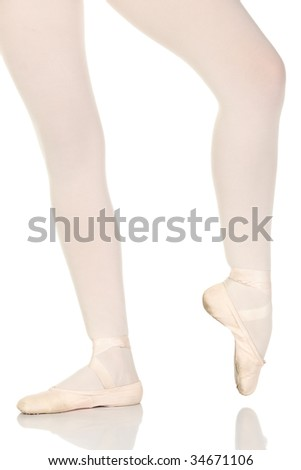 Young caucasian ballerina girl on white background and reflective white floor showing various ballet steps and positions. Not Isolated