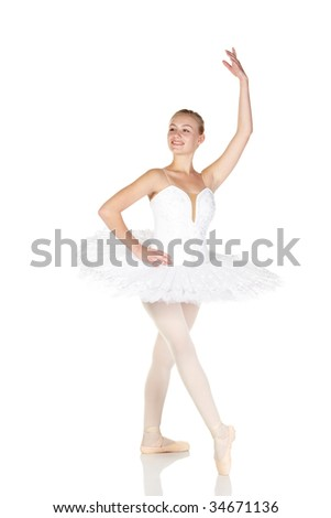 Young caucasian ballerina girl wearing a tutu on white background and reflective white floor showing various ballet steps and positions. Not Isolated