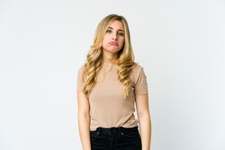 Young caucasian blonde woman sad, serious face, feeling miserable and displeased.