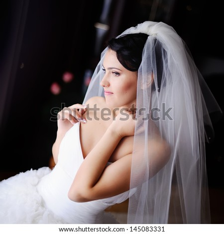 young caucasian brunette bride in the morning